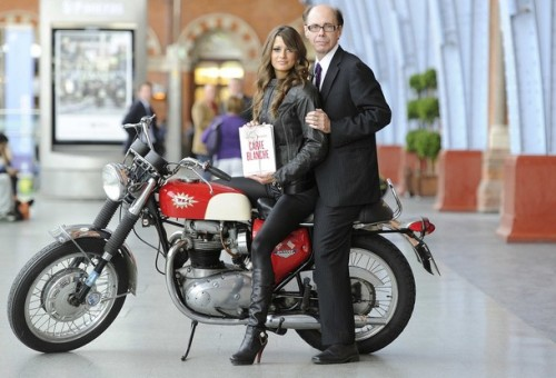 "Thriller writer Jeffery Deaver (R) poses for photographers with model Chesca Miles on a BSA Spitfire motorbike to launch the new James Bond book ""Carte Blanche"" at St Pancras station in London May 25, 2011. REUTERS/Paul Hackett (BRITAIN - Tags: ENTERTAINMENT SOCIETY)"